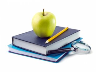 Books with magnifying glass, pencil and apple