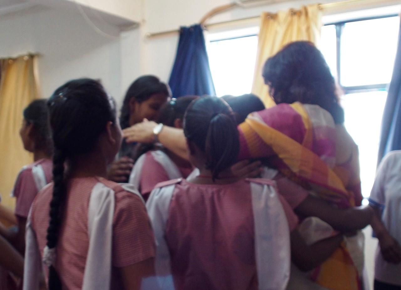 Prerna girls hugging Dr. Urvashi Sahni in a group