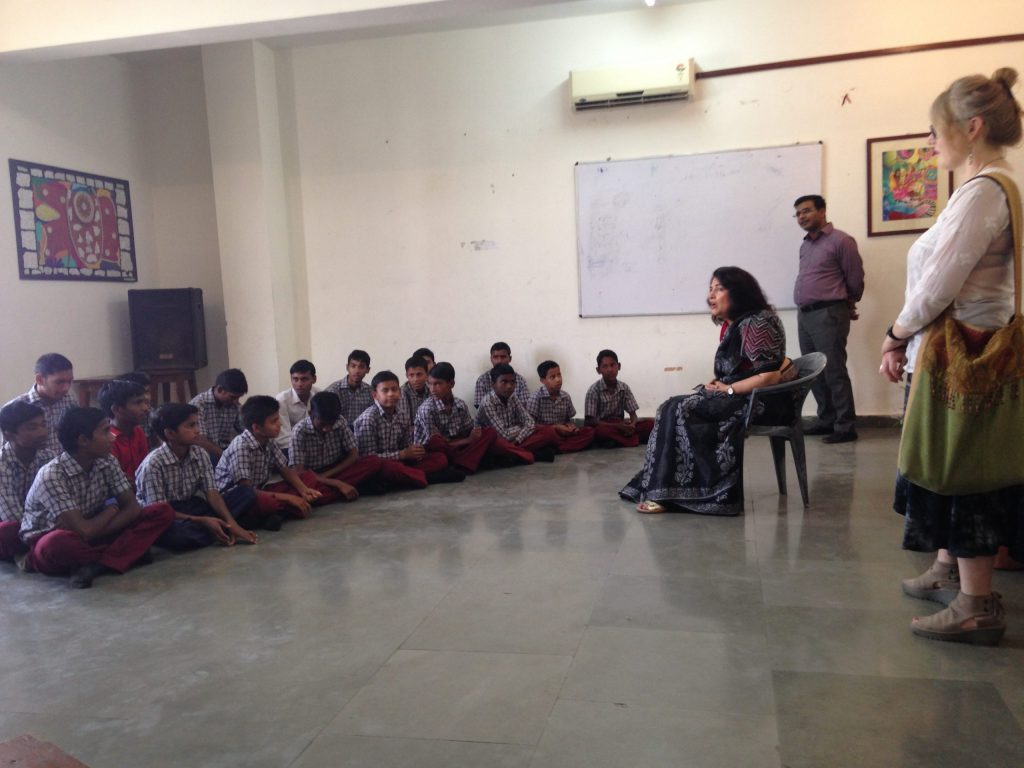 Dr. Urvashi Sahni addressing a group of boys at Prerna