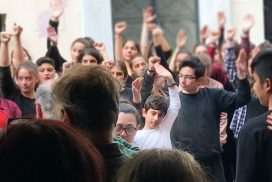 Image of youth in Greece showing solidarity by raising their fists
