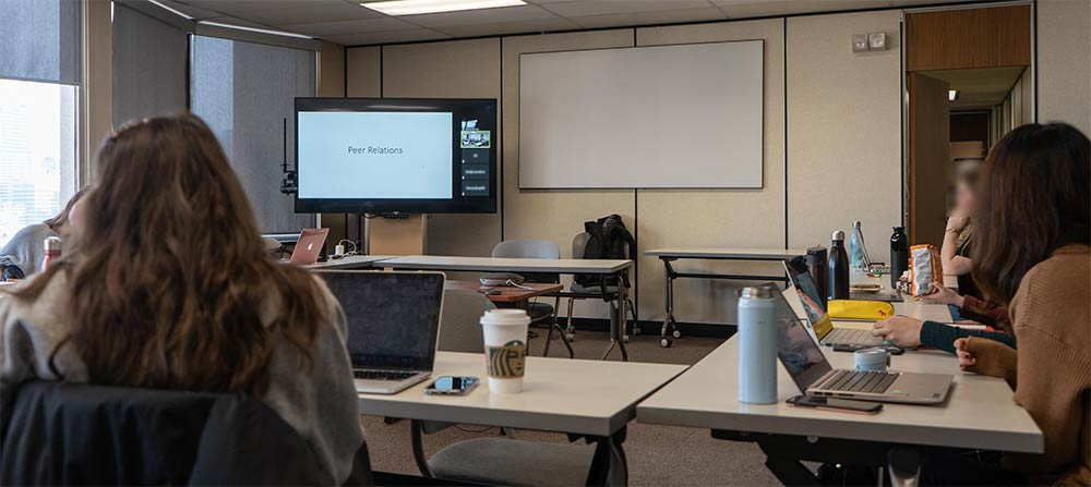 In this class, some students participate face-to-face, while others attend via videoconference.