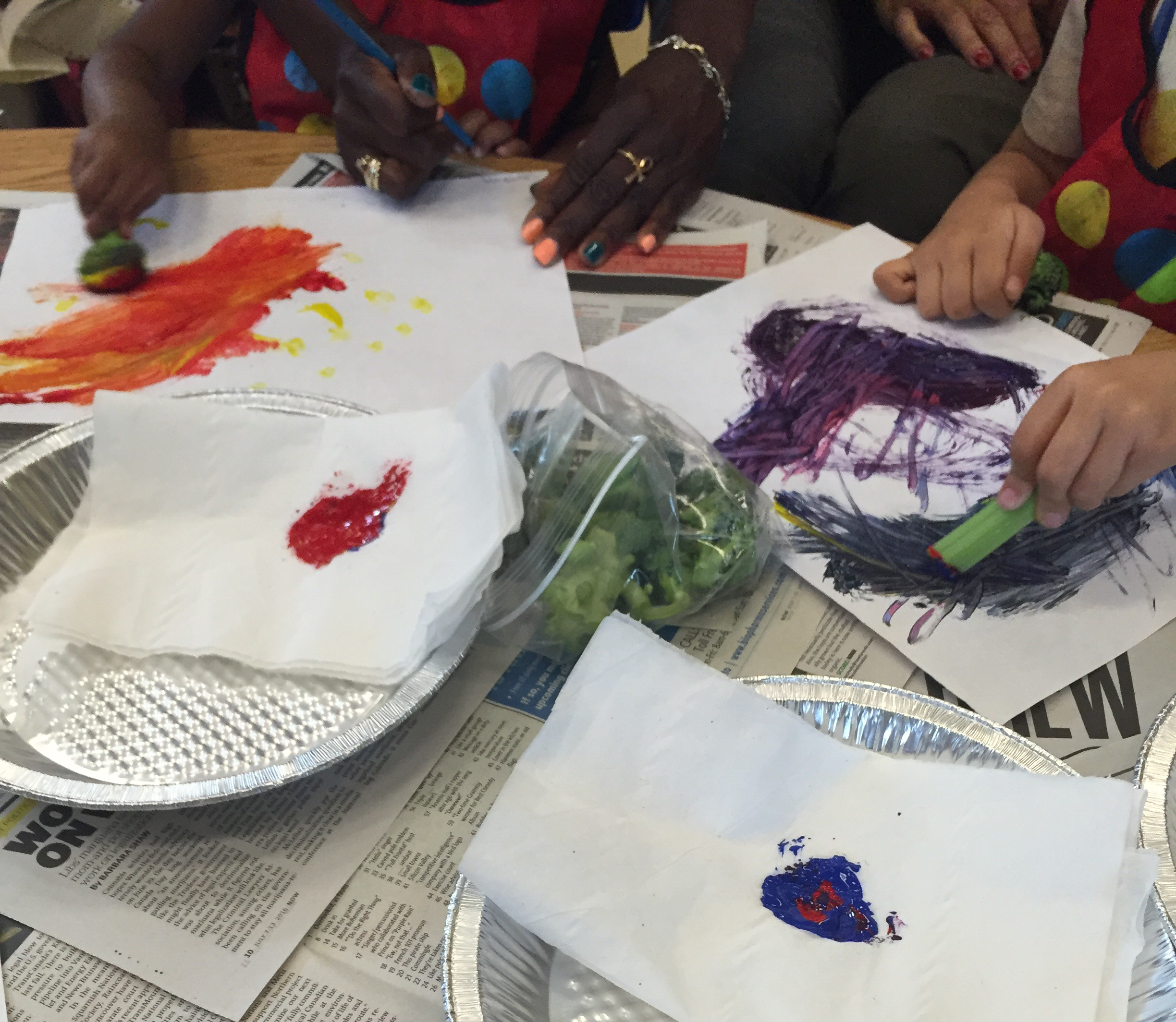 Mixing primary colours with broccoli and celery and making prints