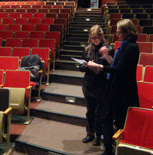 Dr. Gallagher and Anne Wessels review notes
