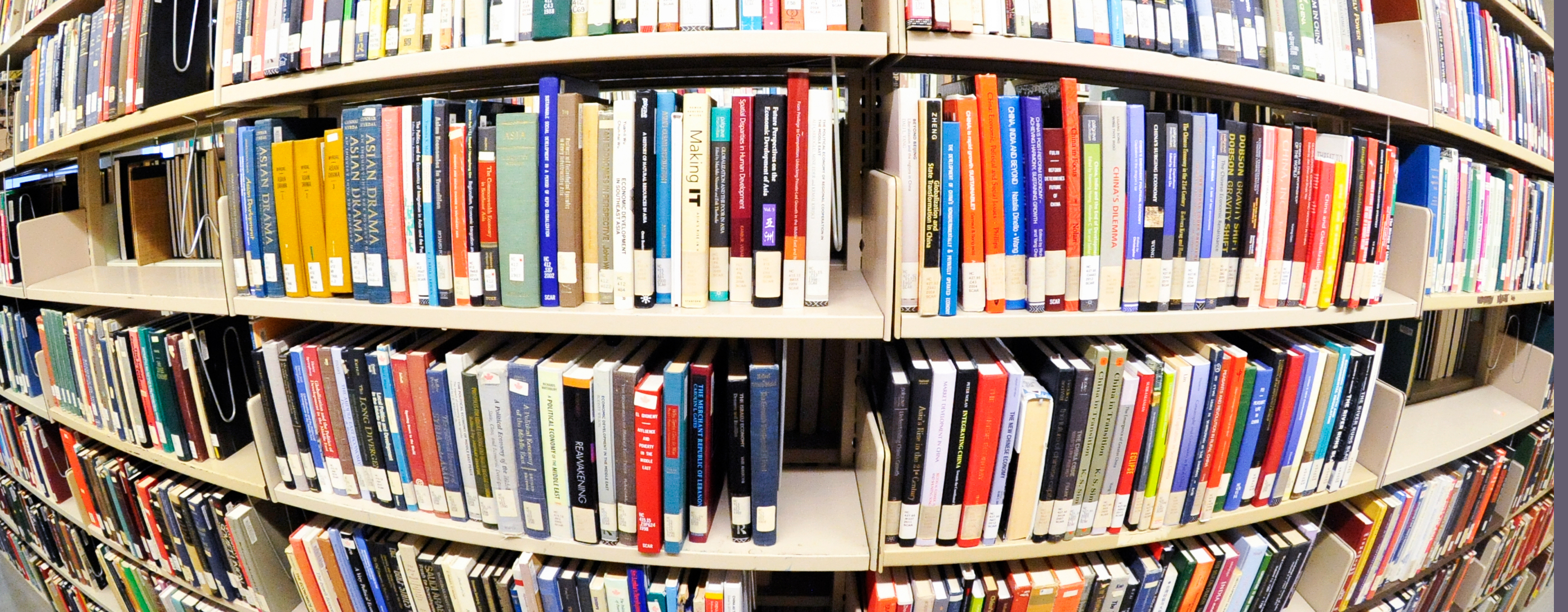 Photograph Of Books On A Library Shelf